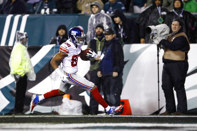 New York Giants' Darius Slayton scores a touchdown during the first half of an NFL football game against the Philadelphia Eagles, Monday, Dec. 9, 2019, in Philadelphia. (AP Photo/Matt Rourke)