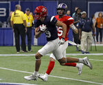 West wide receiver Shawn Poindexter (19), of Arizona, beats East safety Chris Johnson (25), of North Alabama, to the end zone for a touchdown during the second half of the East-West Shrine football game Saturday, Jan. 19, 2019, in St. Petersburg, Fla. (AP Photo/Chris O'Meara)