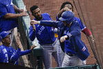Toronto Blue Jays' Danny Jansen, front right, is greeted by teammates after hitting a two-run home run against the Baltimore Orioles during the fourth inning of the first game of a baseball doubleheader, Saturday, Sept. 11, 2021, in Baltimore. (AP Photo/Julio Cortez)