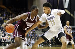 Mississippi State forward Reggie Perry (1) drives against Vanderbilt forward Matthew Moyer (13) in the second half of an NCAA college basketball game Saturday, Jan. 19, 2019, in Nashville, Tenn. (AP Photo/Mark Humphrey)