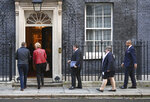 Lawmakers arrive for a Cabinet Meeting, with, from 2nd left, Britain's Business Secretary Andrea Leadsom, Justice Secretary Robert Buckland, Work and Pensions Secretary Therese Coffey and Conservative Party Chairman James Cleverly, arrive at 10 Downing Street in London, Tuesday Oct. 8, 2019. Britain and the European Union appeared to be poles apart Monday on a potential Brexit deal. (Stefan Rousseau/PA via AP)