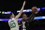 San Antonio Spurs guard Lonnie Walker IV (1) drives past Boston Celtics forward Gordon Hayward (20) during the first half of an NBA basketball game Wednesday, Jan. 8, 2020 in Boston. (AP Photo/Charles Krupa)