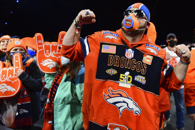 Denver Broncos fans react during the third round of the NFL football draft Friday, April 30, 2021, in Cleveland. (AP Photo/David Dermer)