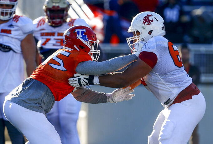 South defensive end Jaylon Ferguson of Louisiana Tech (45) tries to get around South offensive tackle Andre Dillard of Washington State (60) during practice for Saturday's Senior Bowl college football game, Thursday, Jan. 24, 2019, in Mobile, Ala. (AP Photo/Butch Dill)