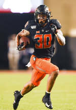 Oklahoma State running back Chuba Hubbard (30) runs for 84 yards during the third quarter of an NCAA college football game in Stillwater, Okla., Saturday, Sept. 28, 2019. Hubbard led Oklahoma State rushing with 296 yards in the 26-13 win over Kansas State. (AP Photo/Brody Schmidt)