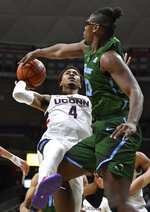 Tulane's Blake Paul blocks a shot attempt by Connecticut's Jalen Adams (4) during the first half of an NCAA college basketball game, Saturday, Jan. 19, 2019, in Storrs, Conn. (AP Photo/Jessica Hill)