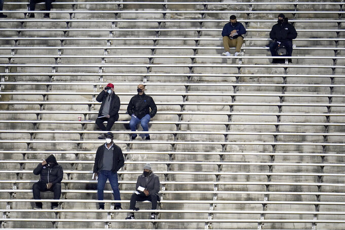 Maryland fans are seen socially distanced during the first half of an NCAA college football game against Minnesota, Friday, Oct. 30, 2020, in College Park, Md. (AP Photo/Julio Cortez)