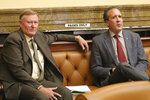 Republican Senate Majority Leader Evan Vickers, left, sits with Rep. Brad Daw, right, R-Orem, following a vote on the Senate floor to change the state's medical marijuana law, Monday, Sept. 16, 2019, in Salt Lake City. A bid to change Utah's medical marijuana law has passed its first vote following a fierce debate from people on both sides of the issue. The Utah Senate has voted unanimously Monday evening to send the proposal to the state's House of Representatives. Two senators were absent. (AP Photo/Rick Bowmer)