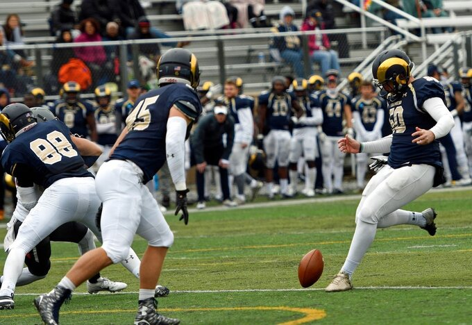 In this Oct. 27, 2018 photo provided by Shepherd University Athletics, Shepherd University kicker Ruan Venter drop kicks and extra point during a college football game against West Virginia Wesleyan in  Shepherdstown, W.Va. Venter dropkicked three extra points in the game. (David Pennock/Shepherd University Athletics via AP)