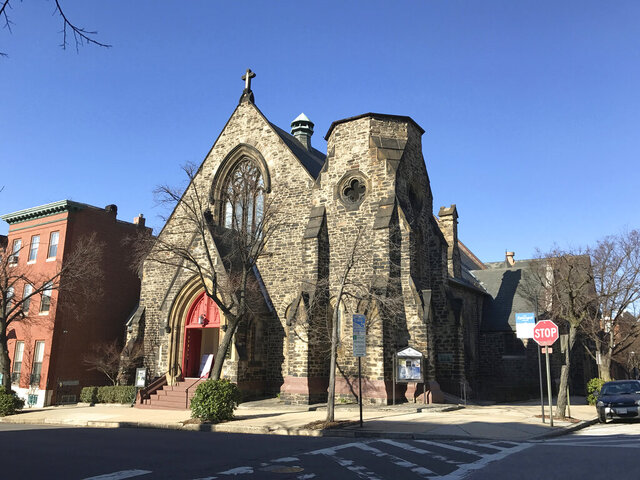 This March 22, 2017, photo provided by Religion News Service shows Memorial Episcopal Church in Baltimore. The historic church has committed to setting aside $100,000 to reparations, an initiative that will contribute to local racial justice causes. Memorial Episcopal Church has also pledged to contribute an additional $400,000 for reparations and justice over five years. (Courtesy of Eli Pousson/Flickr/Religion News Service via AP)