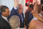 Tunisian independent law professor Kais Saied waves to his supporters after advancing to the second round in the country's presidential elections, in his office in Tunis, Tunisia, Tuesday, Sept.17, 2019. Tunisia's electoral authority says that jailed media magnate Nabil Karoui and independent law professor Kais Saied are advancing to the country's presidential election runoff. (AP Photo/Mosa'ab Elshamy)