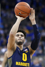 Marquette's Markus Howard shoots a free throw during overtime of the team's NCAA college basketball game against Creighton in Omaha, Neb., Wednesday, Jan. 9, 2019. Howard scored 53 points as Marquette won 106-104. (AP Photo/Nati Harnik)