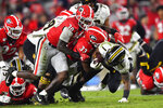 Georgia linebacker Tae Crowder (30) and linebacker Robert Beal Jr. (33) bring down Missouri running back Tyler Badie during the second half of an NCAA college football game Saturday, Nov. 9, 2019, in Athens, Ga. (AP Photo/John Amis)