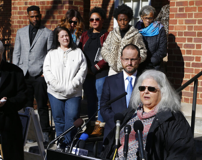 CORRECTS TO  JAMES ALEX FIELDS JR. NOT ALEX JAMES FIELDS JR. - Susan Bro, mother of Heather Heyer, talks to the media in front of Charlottesville Circuit Court after a jury recommended life plus 419 years for James Alex Fields Jr. for the death of Heyer as well as several other charges related to the Unite the Right rally in 2017 in Charlottesville, Va., Tuesday, Dec. 11, 2018. Other victims of Fields attack are in the background. (AP Photo/Steve Helber)