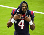 FILE - In this Jan. 3, 2021, file photo, Houston Texans quarterback Deshaun Watson walks off the field before an NFL football game against the Tennessee Titans in Houston. The Texans enter the draft with uncertainty at quarterback after 22 women have filed lawsuits since March 16 alleging that they were sexually assaulted or harassed by Watson. Houston police and the NFL have said they are investigating the allegations, leaving his future with the team up in the air. (AP Photo/Eric Christian Smith, File)