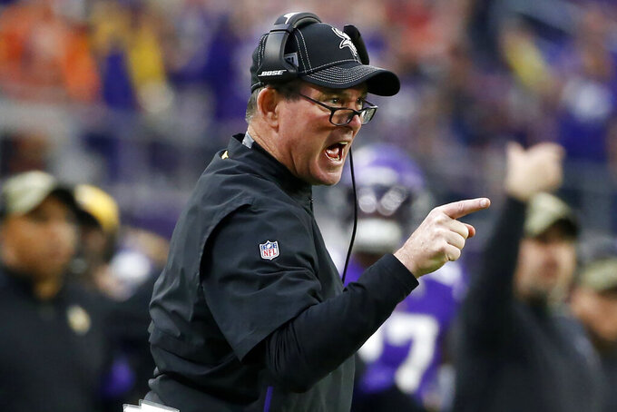 FILE - In this Nov. 17, 2019, file photo, Minnesota Vikings head coach Mike Zimmer reacts to a call during the first half of an NFL football game against the Denver Broncos, in Minneapolis. The Vikings and San Francisco 49ers play in a divisional playoff game on Saturday, Jan. 11, 2020, in San Francisco. (AP Photo/Bruce Kluckhohn, File)