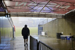 A stadium worker walks through the players' tunnel during a rain delay at Tennessee Titans NFL football training camp in Nissan Stadium, Saturday, Aug. 3, 2019, in Nashville, Tenn. (AP Photo/Mark Humphrey)