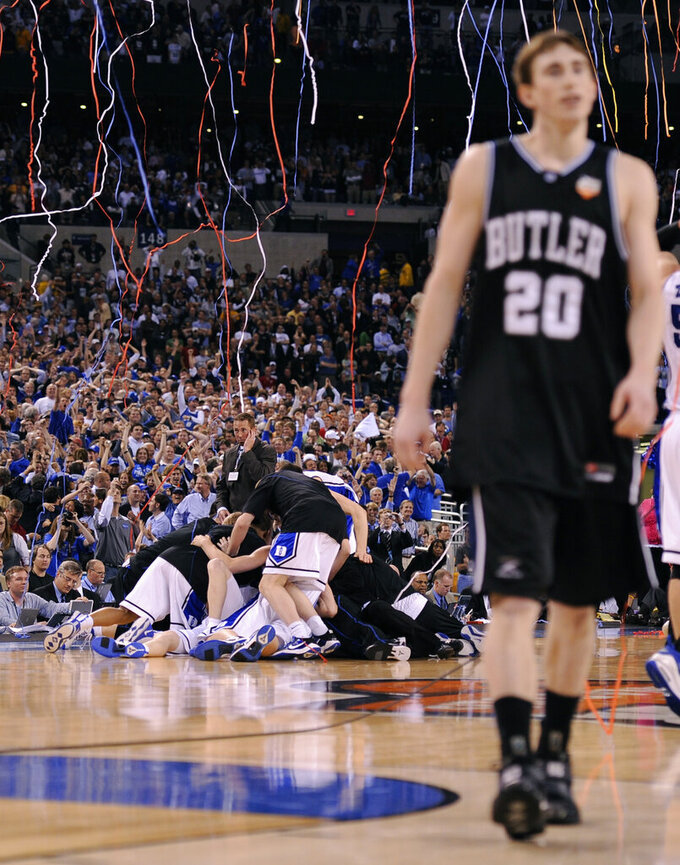 FILE - In this April 5, 2010, file photo, Duke players celebrate as Butler's Gordon Hayward (20) walks off the court at the end of the men's NCAA Final Four college basketball championship game in Indianapolis. Duke won 61-59. (AP Photo/Mark J. Terrill, File)