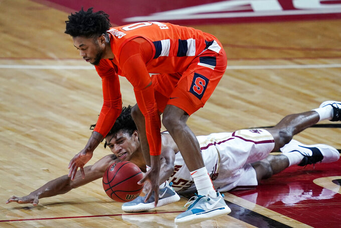 Boston College guard Demarr Langford Jr. (15) dives but Syracuse forward Alan Griffin (0) controls the ball during the second half of an NCAA college basketball game, Saturday, Dec. 12, 2020, in Boston. Syracuse won 101-63. (AP Photo/Elise Amendola)