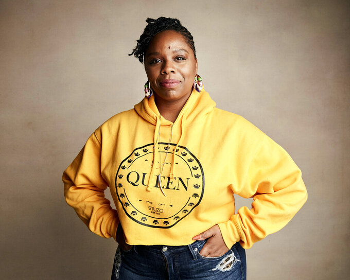 "FILE - In this Jan. 27, 2019, file photo, Patrisse Cullors poses for a portrait to promote a film during the Sundance Film Festival in Park City, Utah. A financial snapshot shared exclusively with The Associated Press shows the Black Lives Matter Global Network Foundation took in just over $90 million last year. Cullors, BLM co-founder, told the AP that the foundation is focused on a ""need to reinvest into Black communities."" (Photo by Taylor Jewell/Invision/AP, File)"