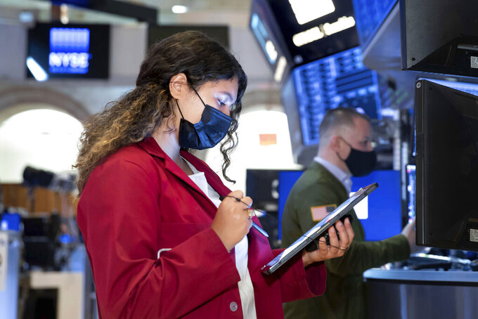 In this photo provided by the New York Stock Exchange, trader Ashley Lara works on the floor, Tuesday June 1, 2021. Stocks were mostly higher Tuesday morning as investors returned from a three-day holiday weekend in the U.S, helped by economic data that showed manufacturing growing steadily as the coronavirus pandemic wanes in the U.S. (Nicole Pereira/New York Stock Exchange via AP)