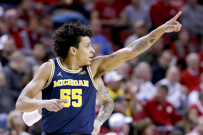 Michigan's Eli Brooks (55) celebrates after scoring a three-point shot during the first half of an NCAA college basketball game against Nebraska in Lincoln, Neb., Tuesday, Jan. 28, 2020. (AP Photo/Nati Harnik)