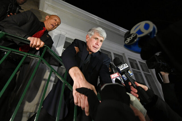 Former Illinois Gov. Rod Blagojevich shakes hands with a supporter as he arrives home in Chicago on Wednesday, Feb. 19, 2020, after his release from Colorado prison late Tuesday. Blagojevich walked out of prison Tuesday after President Donald Trump cut short the 14-year prison sentence handed to the former Illinois governor for political corruption. (AP Photo/Paul Beaty)