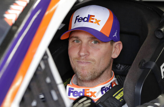 Denny Hamlin waits in his car before practice for Saturday's NASCAR All-Star Cup series auto race at Charlotte Motor Speedway in Concord, N.C., Friday, May 17, 2019. (AP Photo/Chuck Burton)