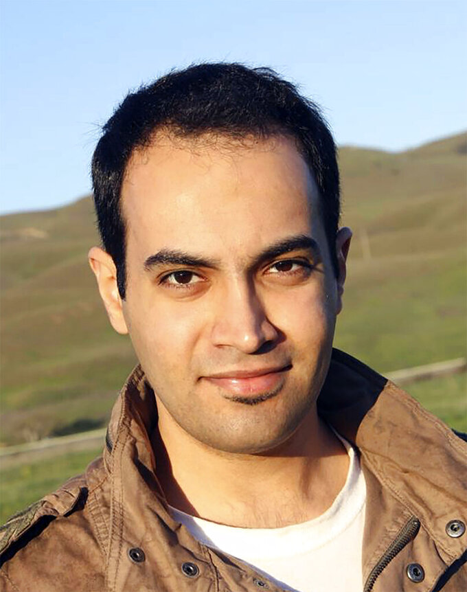 In this undated 2014  photo provided by the family of Abdulrahman al-Sadhan, Abdulrahman al-Sadhan poses for a  photo near San Fransisco, California. Saudi humanitarian aid worker al-Sadhan's anonymous Twitter account used to parody issues about the economy in Saudi Arabia has landed him in prison in the kingdom. But his story may have roots in an elaborate ploy that began in Silicon Valley and sparked a federal case against two Twitter employees accused of spying for the kingdom. (Family of Abdulrahman al-Sadhan via AP)