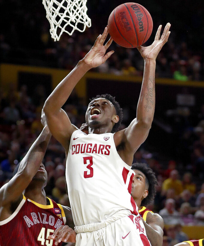 FILE - In this Feb. 7, 2019, file photo, Washington State forward Robert Franks (3) shoots as Arizona State forward Zylan Cheatham (45) defends during the first half of an NCAA college basketball game, in Tempe, Ariz. Franks was named to the AP All-Pac-12 team, Tuesday, March 12, 2019. (AP Photo/Matt York, File)