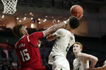 Miami guard Isaiah Wong (2) is fouled by North Carolina State forward Manny Bates (15) during the second half of an NCAA college basketball game, Wednesday, Feb. 5, 2020, in Coral Gables, Fla. North Carolina State won 83-72. (AP Photo/Lynne Sladky)
