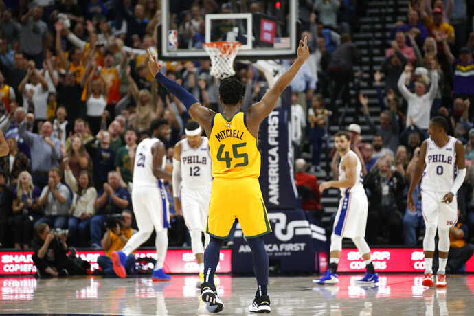 Utah Jazz guard Donovan Mitchell (45) celebrates after a teammate scored against the Philadelphia 76ers during the second half during an NBA basketball game Wednesday, Nov. 6, 2019, in Salt Lake City. (AP Photo/Rick Bowmer)