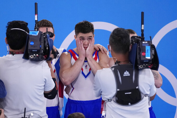 The Russian Olympic Committee's Nikita Nagornyy celebrates after winning the gold medal in the artistic men's team final at the 2020 Summer Olympics, Monday, July 26, 2021, in Tokyo. (AP Photo/Ashley Landis)