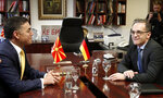 German Foreign Minister Heiko Maas, right, talks with his North Macedonia's counterpart Nikola Dimitrov, at the ministry of foreign affairs in Skopje, North Macedonia, on Wednesday, Nov. 13, 2019.  Maas arrived Wednesday in Skopje to discuss bilateral relations after North Macedonia failed to open European Union membership talks last month. (AP Photo/Boris Grdanoski)