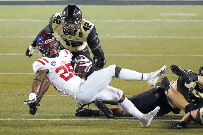 Mississippi running back Henry Parrish Jr. (25) is brought down in front of Vanderbilt defensive back Camden Coleman (42) in the second half of an NCAA college football game Saturday, Oct. 31, 2020, in Nashville, Tenn. Mississippi won 54-21. (AP Photo/Mark Humphrey)