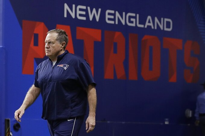 New England Patriots head coach Bill Belichick walks onto the field before the NFL Super Bowl 53 football game between the Los Angeles Rams and the New England Patriots Sunday, Feb. 3, 2019, in Atlanta. (AP Photo/Matt Rourke)