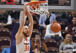 Virginia's Jay Huff dunks the ball during the first half of an NCAA college basketball game against Massachusetts, Saturday, Nov. 23, 2019, in Uncasville, Conn. (AP Photo/Jessica Hill)