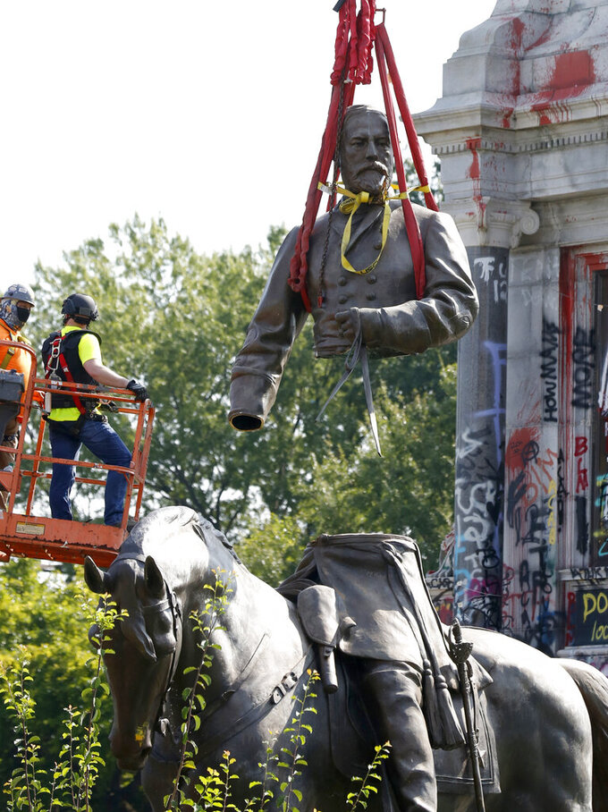 The top part of the General Robert E. Lee statue is lifted during its removal on Monument Avenue in Richmond, Va., Wednesday, Sept. 8, 2021. The statue of Lee that towered over Richmond, Va., for generations has been taken down, cut into pieces and hauled away. It happened as the former capital of the Confederacy erased the last of the Civil War figures that once defined its most prominent thoroughfare. (Daniel Sangjib Min/Richmond Times-Dispatch via AP)