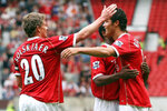 FILE - In this Aug. 12, 2006, file photo, Manchester United's Cristiano Ronaldo, right, celebrates scoring against Sevilla with Ole Gunnar Solskjaer and Patrice Evra during a soccer match in Manchester, England. Ronaldo is headed back to Manchester United. The English club said Friday, Aug. 27, 2021, it has reached an agreement with Juventus for the transfer of the 36-year-old Portugal forward, subject to agreement of personal terms, visa and a medical examination. (Martin Rickett/PA via AP)
