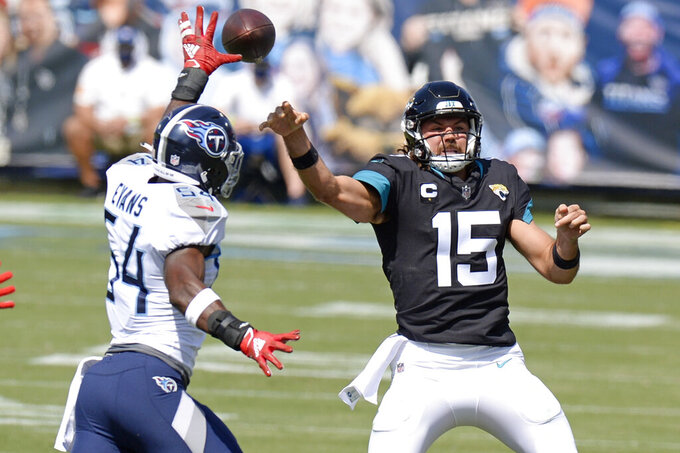 Jacksonville Jaguars quarterback Gardner Minshew (15) passes as he is pressured by Tennessee Titans inside linebacker Rashaan Evans (54) in the first half of an NFL football game Sunday, Sept. 20, 2020, in Nashville, Tenn. (AP Photo/Mark Zaleski)
