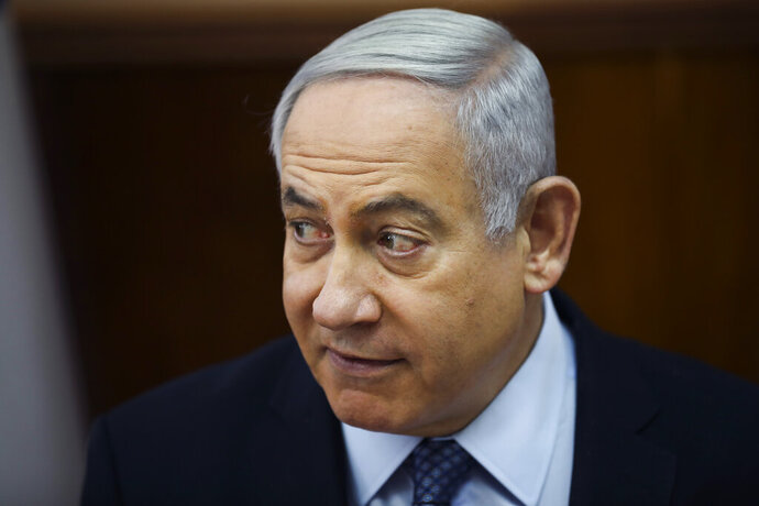 File - In this Sunday, Nov. 3, 2019 file photo, Israeli Prime Minister Benjamin Netanyahu, chairs the weekly cabinet meeting at the Prime Minister's office in Jerusalem. Israel's Justice Ministry says the attorney general will deliver his long-awaited decision on whether to indict Prime Minister Benjamin Netanyahu in a series of corruption cases.(AP Photo/Oded Balilty, pool, File)