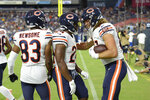 Chicago Bears tight end Jesper Horsted, right, is congratulated by running back Khalil Herbert (24) and wide receiver Dazz Newsome (83) after Horsted scored a touchdown against the Tennessee Titans in the first half of a preseason NFL football game Saturday, Aug. 28, 2021, in Nashville, Tenn. (AP Photo/Mark Zaleski)