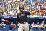 Boston Red Sox's Xander Bogaerts celebrates in the fourth inning of a baseball game against the Toronto Blue Jays in Toronto, Sunday, Aug. 8, 2021. (Christopher Katsarov/The Canadian Press via AP)