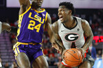 Georgia guard Tyree Crump (4) looks for an open shot while defended by LSU forward Emmitt Williams (24) during an NCAA college basketball game in Athens, Ga., Saturday, Feb. 16, 2019. (Joshua L. Jones/Athens Banner-Herald via AP)