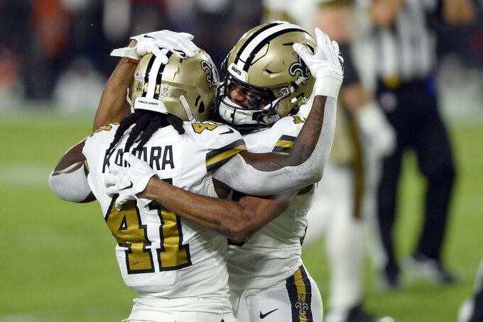 New Orleans Saints wide receiver Tre'Quan Smith celebrates his touchdown reception against the Tampa Bay Buccaneers with running back Alvin Kamara (41) during the first half of an NFL football game Sunday, Nov. 8, 2020, in Tampa, Fla. (AP Photo/Jason Behnken)