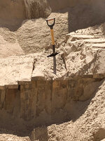 In this undated photo provided by U.S. Immigration and Customs Enforcement, a shovel sticks out of the sand as excavation work continues at a site of an incomplete tunnel intended for smuggling, found stretching from Arizona to Mexico. (Courtesy of ICE via AP)
