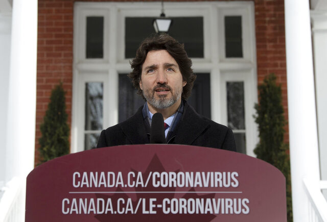 Canadian Prime Minister Justin Trudeau delivers his opening remarks at a news conference outside Rideau cottage in Ottawa, Ontario, Tuesday, Jan. 19, 2021. (Adrian Wyld/The Canadian Press via AP)