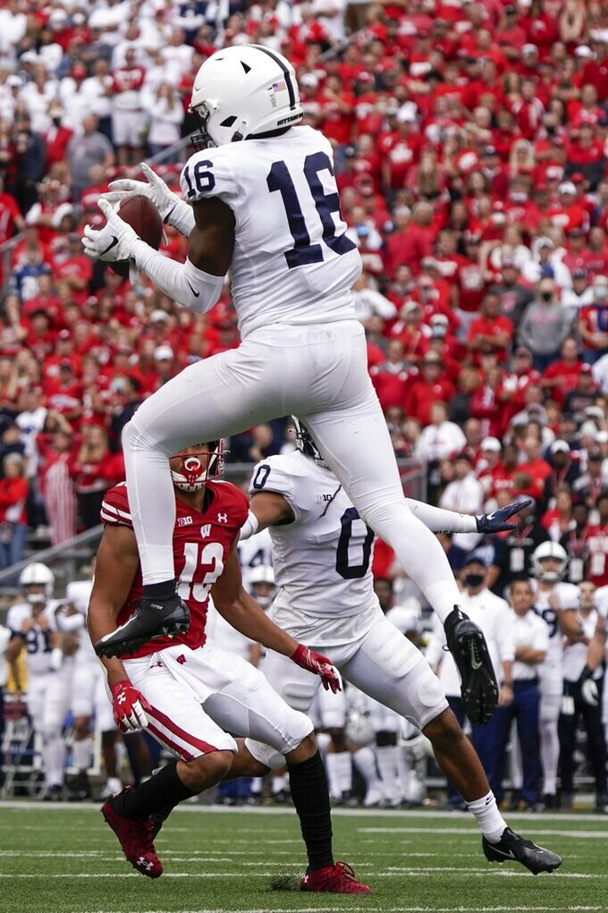 Penn State's Ji'Ayir Brown intercepts a pass in the final second of the second half of an NCAA college football game against Wisconsin Saturday, Sept. 4, 2021, in Madison, Wis. Penn State won 16-10. (AP Photo/Morry Gash)
