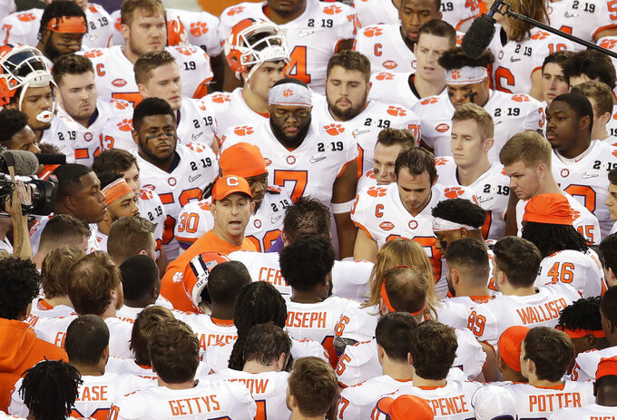 Clemson head coach Dabo Swinney leads a huddle before the NCAA college football playoff championship game against Alabama, Monday, Jan. 7, 2019, in Santa Clara, Calif. (AP Photo/Jeff Chiu)