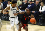 Oregon State forward Alfred Hollins, right, drives to the net as Colorado guard Tyler Bey defends in the first half of an NCAA college basketball game Sunday, Jan. 5, 2020, in Boulder, Colo. (AP Photo/David Zalubowski)